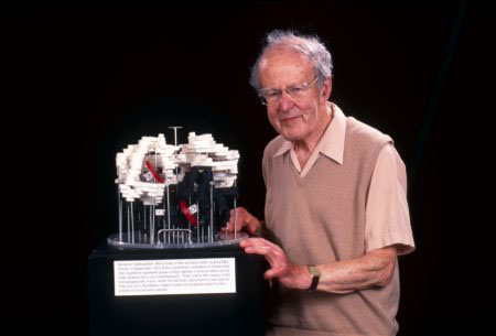 Max Perutz with his 1959 model of haemoglobin, photographed after it was re-built c. 2000.