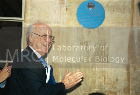 Jim Watson outside The Eagle public house, Cambridge, following the unveiling of a commemorative plaque to celebrate 50 years of the DNA double helix, 25 April 2003.