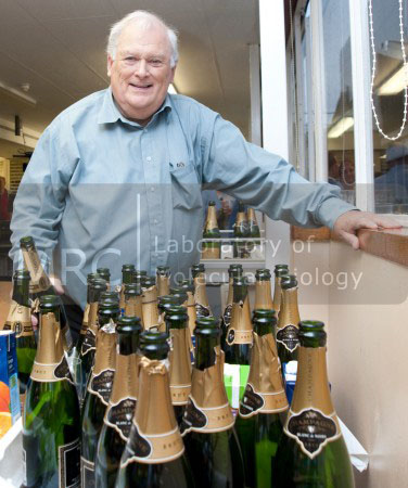 Michael Fuller serving champagne at the Nobel Party for Venki Ramakrishnan, 7 October 2009, in the LMB canteen.