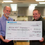 Hugh Pelham presents large cheque to BHF's Nigel Cole