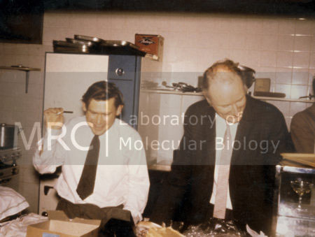 Sydney Brenner and Francis Crick at a party in the LMB canteen to celebrate Max Perutz and John Kendrew's 1962 Nobel Prize.