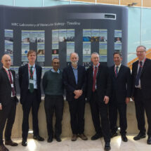 Committee on Exiting the EU standing with Hugh Pelham and Venki Ramakrishnan in front of the LMB timeline