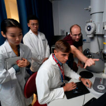 LIYSF students operating an electron microscope to look at virus particles