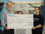LMB give cheque to Cancer research UK