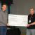 Jan Löwe presents John Mochan from Prostate Cancer UK with the LMB's donation