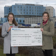 LMB raffle cheque outside the new Papworth Hospital