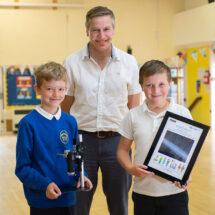 Simon Bullock awarding a digital microscope to pupils at R A Butler Academy