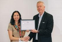 Nicola Smyllie receiving award from John Savill