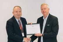 Richard Pannell receiving award from John Savill